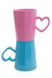 Tazas rosadas y azules, aisladas Fotos de archivo libres de regalías