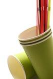 Tazas verdes con la paja Foto de archivo