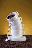Tazas y habas de Coffe Foto de archivo