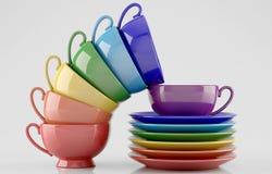 Tazas y platillos coloridos Fotos de archivo