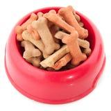 Tazón de fuente con las galletas del perro Imagen de archivo libre de regalías