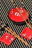 Tazones de fuente de arroz y palillos japoneses Foto de archivo libre de regalías