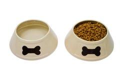 Tazones de fuente del perro con el alimento y agua Fotografía de archivo