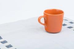 Tazza arancio di offee Fotografia Stock