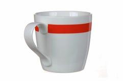 Tazza bianca con la banda rossa Fotografie Stock