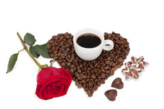 Tazza con caffè, i biscotti e le caramelle Fotografia Stock