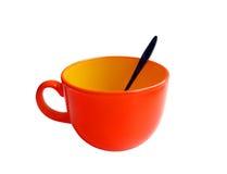 Tazza con il cucchiaio Fotografia Stock