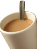 Tazza con tè ed il cucchiaio Fotografia Stock