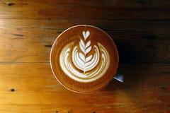 Tazza del caffè di arte del latte Fotografia Stock