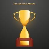 Tazza del premio dell'oro sul supporto Immagini Stock