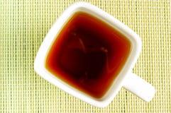 Tazza del quadrato bianco di tè Fotografie Stock