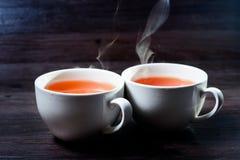 Tazza della bevanda calda con vapore Immagine Stock