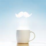 Tazza di caffè con i baffi fotografia stock