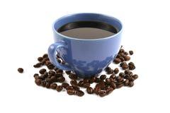 Tazza di caffè con i chicchi di caffè Fotografia Stock