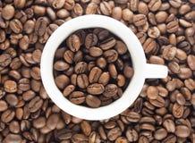 Tazza di caffè con i fagioli Fotografie Stock