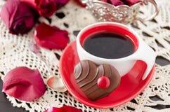 Tazza di caffè con i fiori Immagini Stock