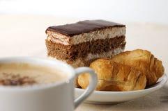 Tazza di caffè con il dessert Fotografie Stock