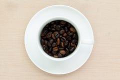 Tazza di caffè con il fagiolo Immagine Stock