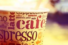 Tazza di caffè con il primo piano di parole Fotografia Stock