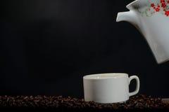 Tazza di caffè con il vaso Fotografia Stock