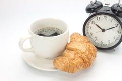 Tazza di caffè con un croissant Immagine Stock