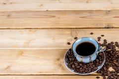 Tazza di caffè d'annata su una tavola di legno Fotografie Stock