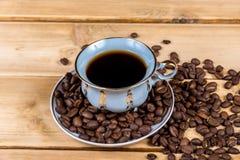 Tazza di caffè d'annata su una tavola di legno Fotografia Stock Libera da Diritti
