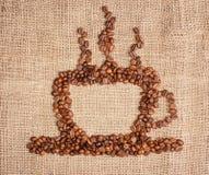 Tazza di caffè dai fagioli Fotografia Stock