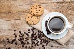 Tazza di caffè e biscotti Fotografia Stock
