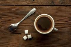 Tazza di caffè e cubi di Surgar Fotografia Stock