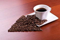 Tazza di caffè e freccia Fotografia Stock