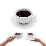 Tazza di caffè e mano di una donna che tiene una tazza di caffè Fotografie Stock Libere da Diritti