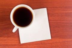 Tazza di caffè e tovagliolo Fotografia Stock Libera da Diritti