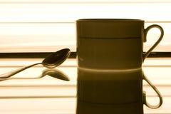Tazza di caffè ed il cucchiaio Immagine Stock