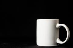 Tazza di caffè isolata sul nero Fotografia Stock