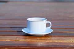 Tazza di caffè su di legno (fondo d'annata) Fotografie Stock