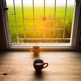 Tazza di caffè su legno Fotografia Stock