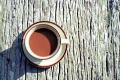 Tazza di caffè su teble di legno Fotografia Stock Libera da Diritti