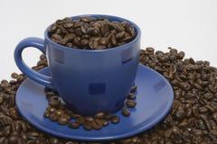 Tazza di caffè su una priorità bassa bianca Fotografie Stock
