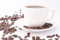 Tazza di caffè su una priorità bassa bianca Immagine Stock Libera da Diritti