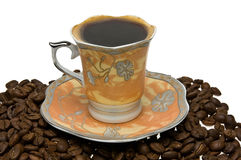 Tazza di caffè su una priorità bassa bianca Immagini Stock Libere da Diritti