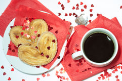 Tazza di caffè su una priorità bassa rossa Fotografie Stock
