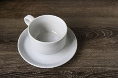 Tazza di caffè sul pavimento di legno. Fotografie Stock Libere da Diritti