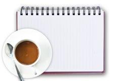 Tazza di caffè sul taccuino Immagine Stock