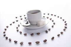 Tazza di Coffe e spirale dei granuli Fotografia Stock