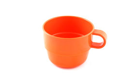 Tazza di plastica arancione Immagini Stock