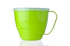 Tazza di plastica verde Fotografia Stock