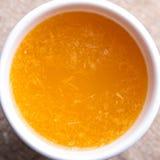Tazza di succo d'arancia fresco Fotografia Stock