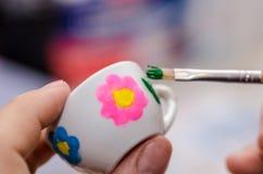 Tazza di tè ceramica dipinta casa Fotografie Stock