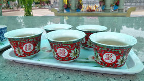 Tazza di tè cinese rossa sull'altare di marmo brillante Immagine Stock Libera da Diritti